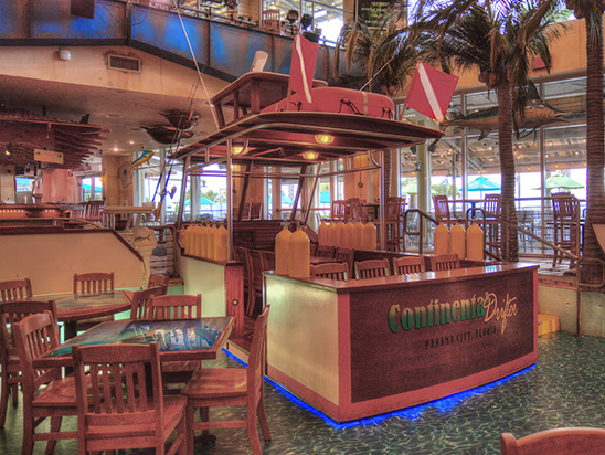 Pontoon Boat interior with wooden chairs and tables